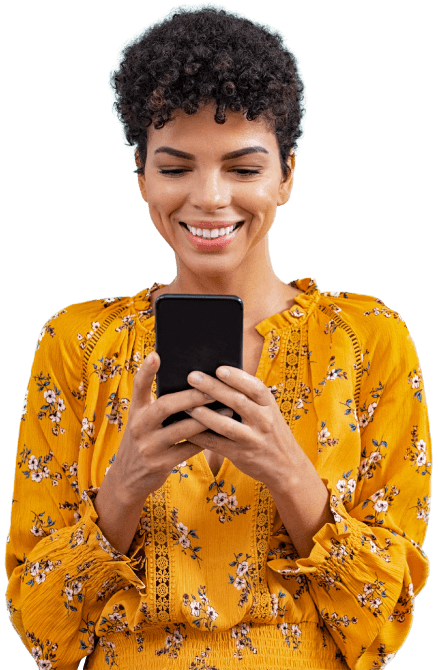 Young woman smiling at her phone